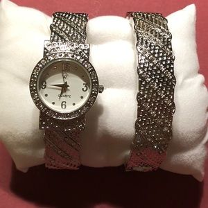 Silver toned bangle watch and bracelet.